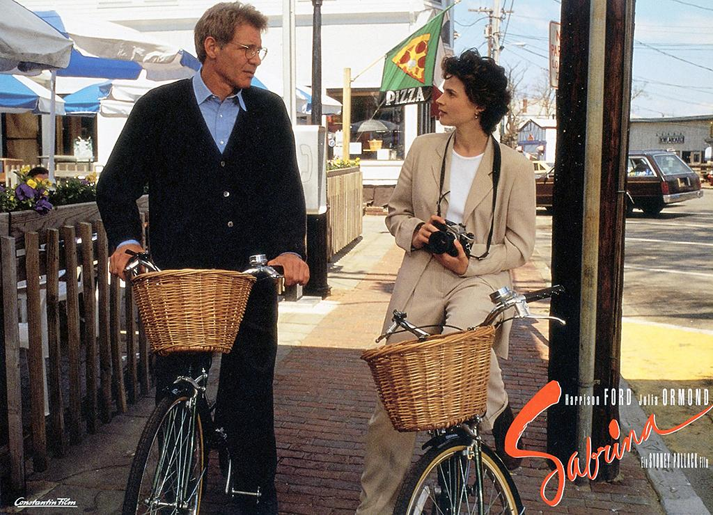 <p>Harrison Ford, Julia Ormond, and Greg Kinnear headline this 1995 remake of the 1954 Billy Wilder classic (which starred Humphrey Bogart, Audrey Hepburn, and William Holden). Ford plays a man who tries to save his brother's impending marriage by wooing the new woman he's falling for— only to fall for her himself. (Photo: Everett) </p>
