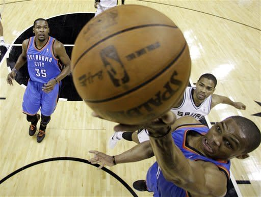 Oklahoma City Thunder point guard Russell Westbrook, right, shoots as small forward Kevin Durant (35) and San Antonio Spurs point guard Gary Neal (14) watch during the first half of Game 5 in the NBA basketball Western Conference finals, Monday, June 4, 2012, in San Antonio. (AP Photo/Eric Gay, Pool)