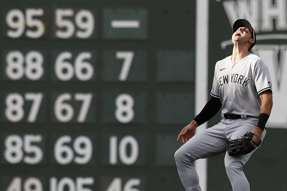 New York Yankees' Joey Gallo looks for the ball in the sun on the fly out by Boston Red Sox's Kyle Schwarber during the second inning of a baseball game, Saturday, Sept. 25, 2021, in Boston. (AP Photo/Michael Dwyer)