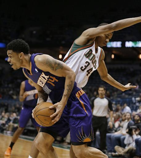 Dragic scores 30, injures elbow in Suns' win