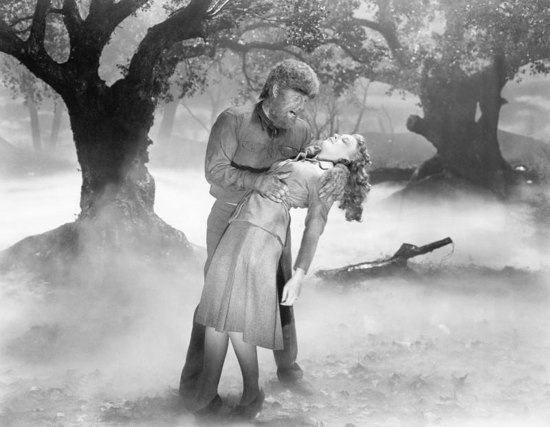 """(Original Caption) 1941- Picture shows actor Lon Chaney Jr., grabbing actress, Evelyn Ankers, in the Universal picture, """"The Wolfman."""" (Photo by George Rinhart/Corbis via Getty Images)"""