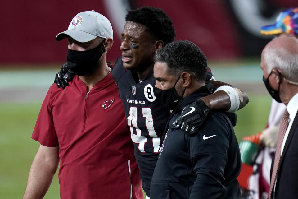 Arizona Cardinals running back Kenyan Drake (41) is helped off the field after an injury during the second half of an NFL football game against the Seattle Seahawks, Sunday, Oct. 25, 2020, in Glendale, Ariz. (AP Photo/Ross D. Franklin)