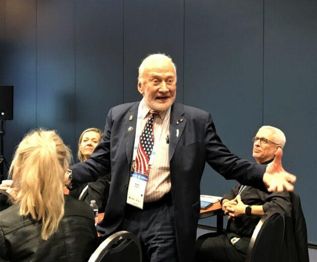 During a discussion presented by the International Academy of Astronautics in Washington, D.C., Apollo 11 moonwalker Buzz Aldrin recalls how enthusiastically he and his crewmates were greeted during a post-mission goodwill tour.(GeekWire Photo / Alan Boyle)