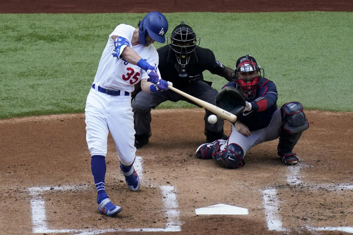 Los Angeles Dodgers' Cody Bellinger hits a RBI-single against the Atlanta Braves during the first inning in Game 6 of a baseball National League Championship Series Saturday, Oct. 17, 2020, in Arlington, Texas. (AP Photo/Sue Ogrocki)