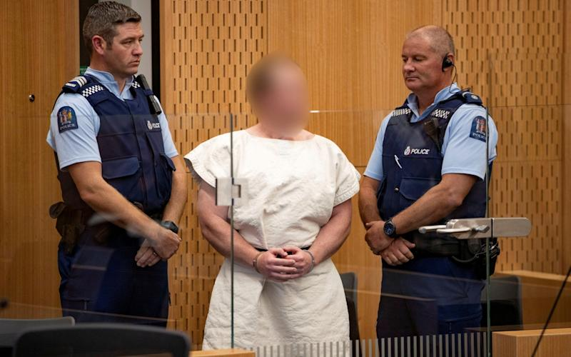 Brenton Tarrant, pictured here in the dock at Christchurch District Court, will now face 92 charges following the March mosque shooting - REUTERS