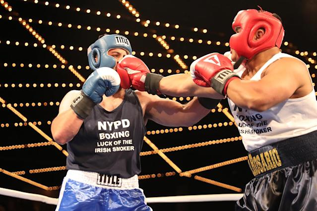 <p>Carlos Del Rosario leans with a punch in the ring against Josue Torres in the NYPD Boxing Championships at the Theater at Madison Square Garden on June 8, 2017. (Photo: Gordon Donovan/Yahoo News) </p>