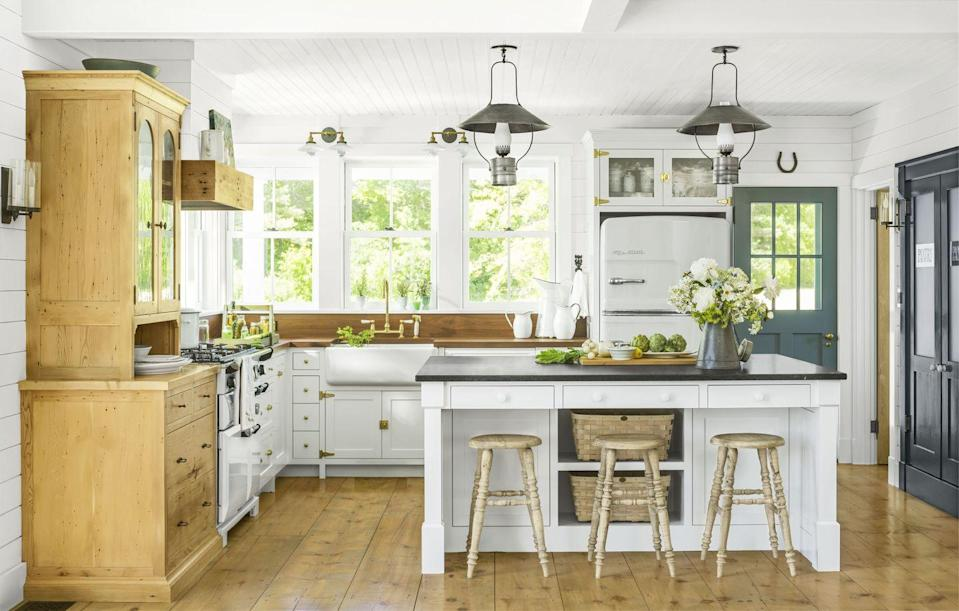 "<p>For those who fear color, focus on mixing up the finishes. Designer Cathy Chapman chose white beadboard on the ceiling and shiplap for the walls. She used unlacquered brass strap hinges and latches on the cabinets, black marble on the island countertop, and tons of warm woods on the floors, backsplash, and remaining countertops.<br></p><p><a class=""link rapid-noclick-resp"" href=""https://www.amazon.com/Primed-Pine-Nickel-Board-6-Pieces/dp/B077K6SRH6?tag=syn-yahoo-20&ascsubtag=%5Bartid%7C10050.g.3988%5Bsrc%7Cyahoo-us"" rel=""nofollow noopener"" target=""_blank"" data-ylk=""slk:SHOP SHIPLAP"">SHOP SHIPLAP</a></p>"