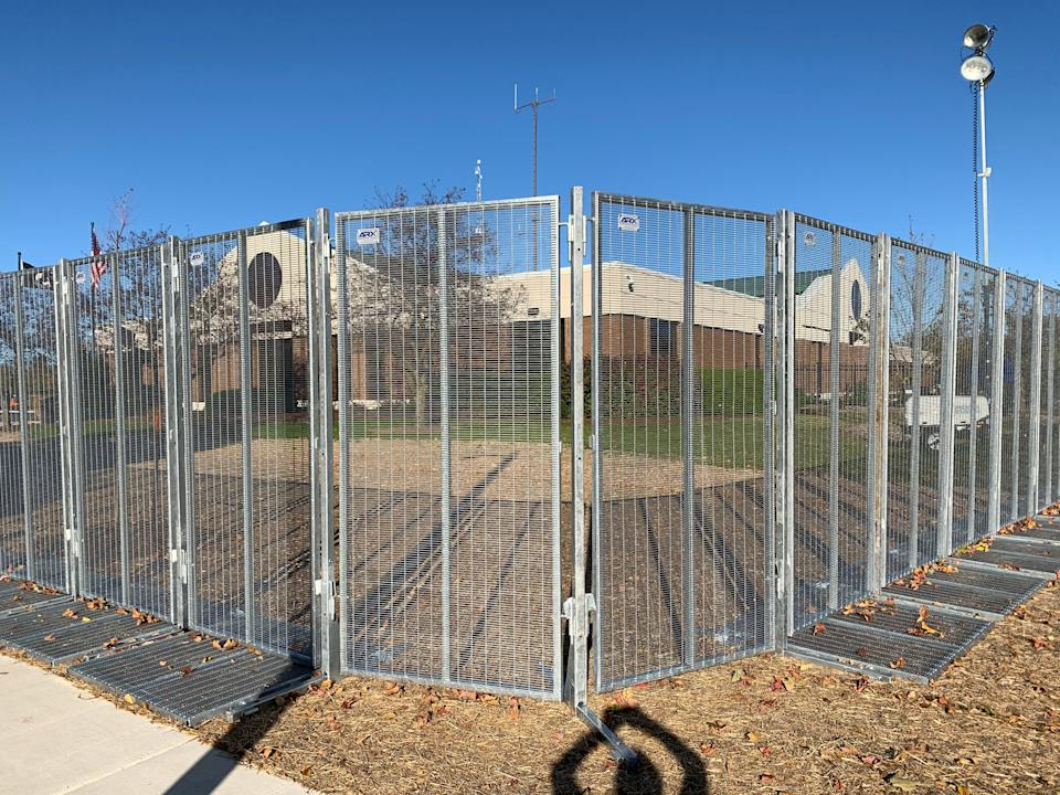 The Wauwatosa Police Department was surrounded by fencing on Wednesday, Oct. 7, 2020. The fencing was put up in response to protests following the district attorney's decision not to charge a police officer in a fatal shooting in the city.