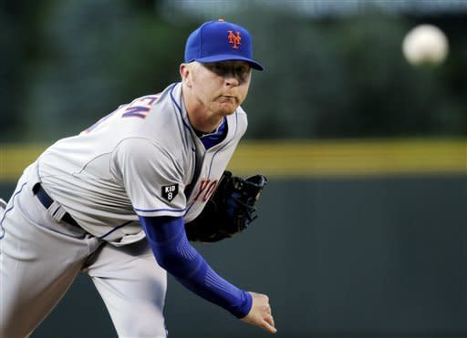 New York Mets starting pitcher Chris Schwinden throws against the Colorado Rockies in the first inning of their baseball game in Denver on Friday, April 27, 2012. (AP Photo/Joe Mahoney)