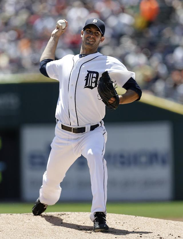 Detroit Tigers pitcher Rick Porcello throws against the Baltimore Orioles in the first inning of a baseball game in Detroit, Wednesday, June 19, 2013. (AP Photo/Paul Sancya)