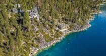 """<p>The homes sitting on the shores of the Sierra-region lake boast price tags that head upwards of <a href=""""https://www.forbes.com/sites/jimdobson/2017/07/15/lake-tahoe-breaks-records-with-new-mansion-listings-including-a-75-million-estate/#2596ba137a49"""" rel=""""nofollow noopener"""" target=""""_blank"""" data-ylk=""""slk:$75 million"""" class=""""link rapid-noclick-resp"""">$75 million</a>! The lake, which attracts everyone from Hollywood studio execs to San Francisco tech players, sits on the California/Nevada state line and is the ideal spot for adventurers year round.</p><p>Photo: <a href=""""https://www.crystalpointetahoe.com/slideshow-1"""" rel=""""nofollow noopener"""" target=""""_blank"""" data-ylk=""""slk:Jeff Dow Photography"""" class=""""link rapid-noclick-resp"""">Jeff Dow Photography</a></p>"""