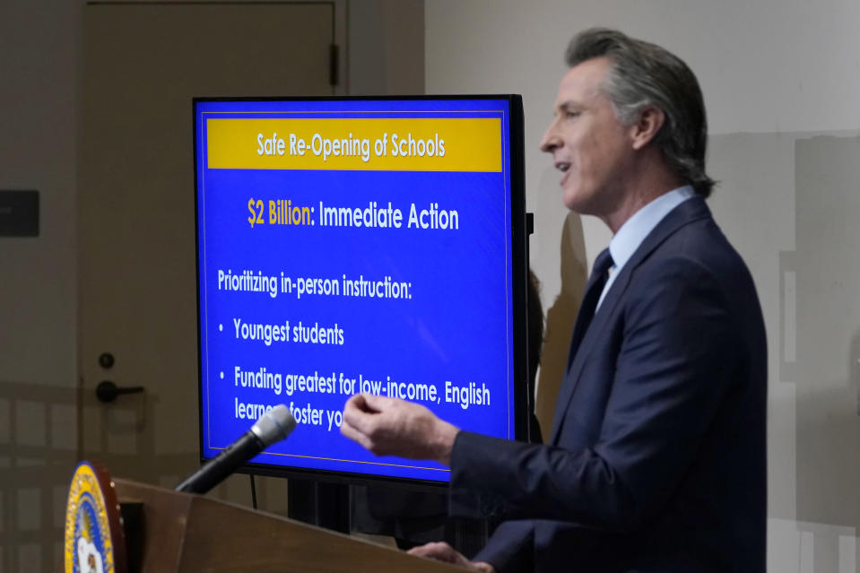 """FILE - In this Jan. 8, 2021, file photo, California Gov. Gavin Newsom outlines his 2021-2022 state budget proposal during a news conference in Sacramento, Calif. California Democratic leaders are being criticized after attempting to link the insurrection at the U.S. Capitol with efforts to recall Newsom. State Democratic Party Chair Rusty Hicks led a group of Democratic officials who described the effort to remove Newsom as a """"coup"""" and claimed, without evidence, that those involved were far-right extremists. (AP Photo/Rich Pedroncelli, Pool, File)"""