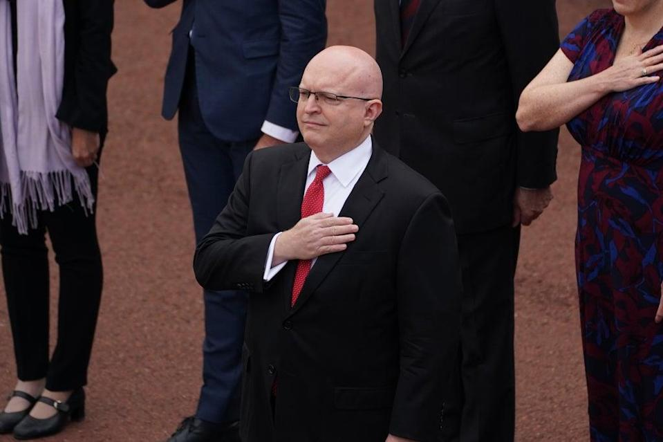 Acting ambassador Philip takes the salute as the US national anthem is played (Steve Parsons/PA) (PA Wire)