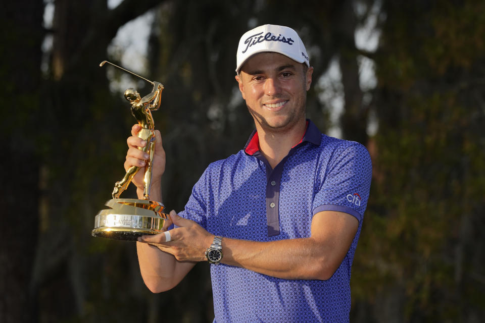 Justin Thomas holds the trophy after winning The Players Championship golf tournament Sunday, March 14, 2021, in Ponte Vedra Beach, Fla.(AP Photo/John Raoux)