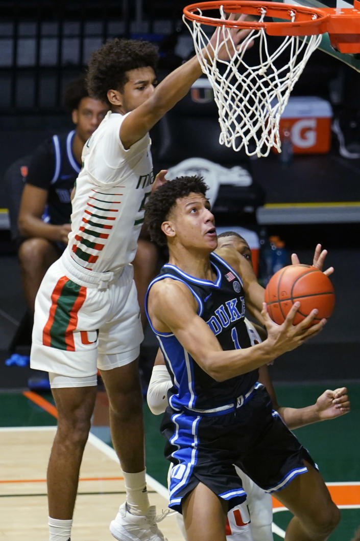 FILE - In this Feb. 1, 2021, file photo, Duke forward Jalen Johnson (1) drives to the basket as Miami guard Harlond Beverly (5) defends during an NCAA college basketball game in Coral Gables, Fla. Johnson was selected by the Atlanta Hawks in the NBA draft Thursday, July 29. (AP Photo/Marta Lavandier, File)