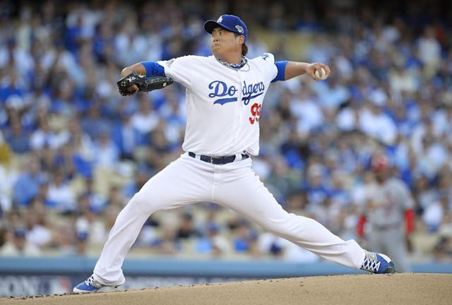 Los Angeles Dodgers starting pitcher Hyun-Jin Ryu throws during the first inning of Game 3 of the National League baseball championship series against the St. Louis Cardinals, Monday, Oct. 14, 2013, in Los Angeles. (AP Photo/Mark J. Terrill)