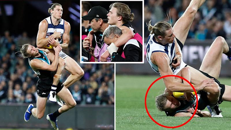 Pictured here, Port Adelaide's Xaxier Duursma is helped off the field after being concussed against Geelong.