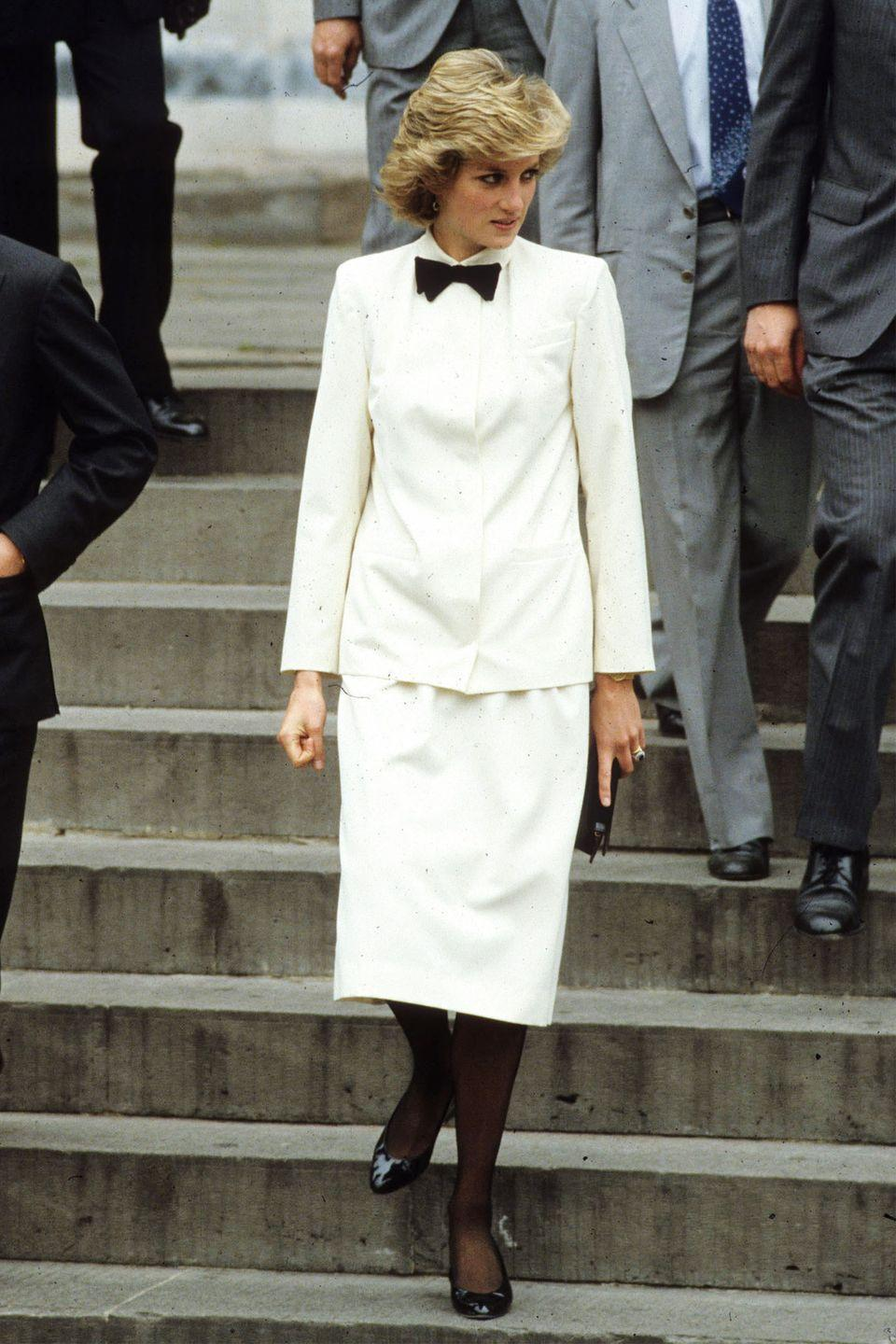 <p>In a white suit with a black bow tie by Jasper Conran in Florence during the Royal Tour of Italy. </p>