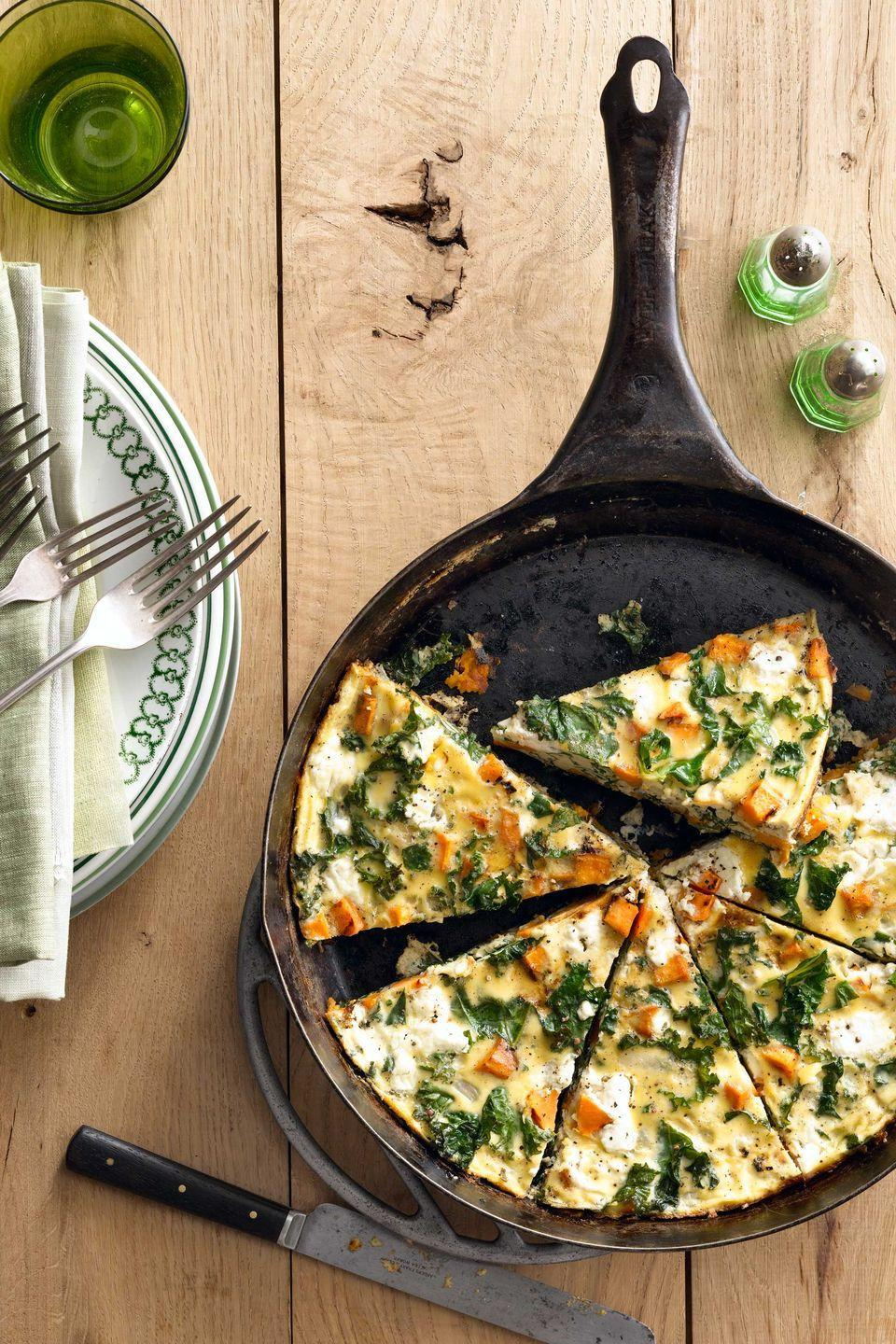 """<p>The whole family will gobble up this delicious and easy frittata that is perfect for breakfast, lunch, or dinner. </p><p><strong><a href=""""https://www.countryliving.com/food-drinks/recipes/a5502/sweet-potato-kale-frittata-recipe-clx0914/"""" rel=""""nofollow noopener"""" target=""""_blank"""" data-ylk=""""slk:Get the recipe"""" class=""""link rapid-noclick-resp"""">Get the recipe</a>.</strong></p><p><strong><a class=""""link rapid-noclick-resp"""" href=""""https://www.amazon.com/GreaterGoods-Skillet-Pre-Seasoned-handmade-Certified/dp/B07PP9TPRZ/?tag=syn-yahoo-20&ascsubtag=%5Bartid%7C10050.g.877%5Bsrc%7Cyahoo-us"""" rel=""""nofollow noopener"""" target=""""_blank"""" data-ylk=""""slk:SHOP CAST IRONS SKILLETS"""">SHOP CAST IRONS SKILLETS</a><br></strong></p>"""