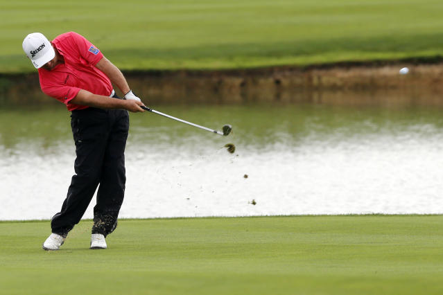 Graeme McDowell of Northern Ireland plays a shot, during the last day of the French Open Golf tournament at Paris National course in Guyancourt, west of Paris, France, Sunday, July 6, 2014. (AP Photo/Francois Mori)