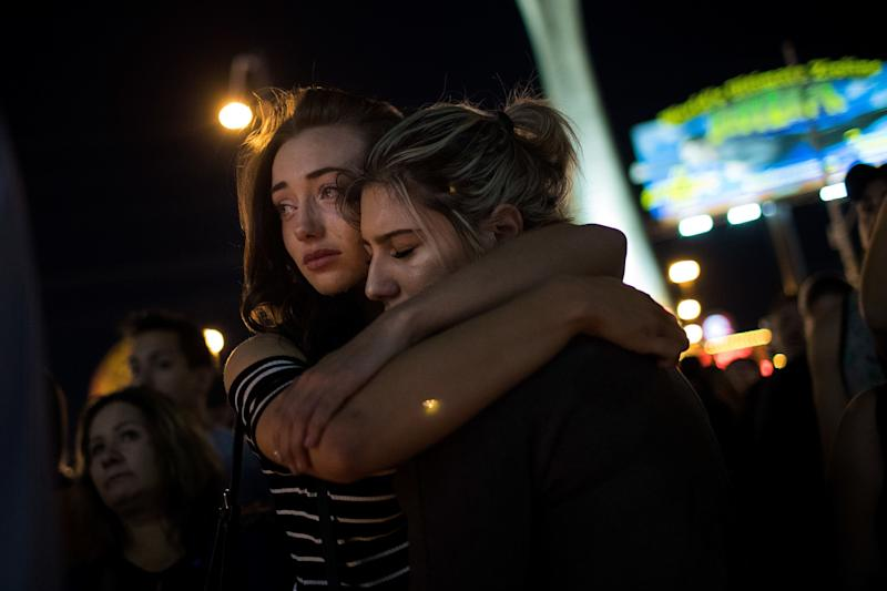 Mourners attend a candlelight vigil at the corner of Sahara Avenue and Las Vegas Boulevard.