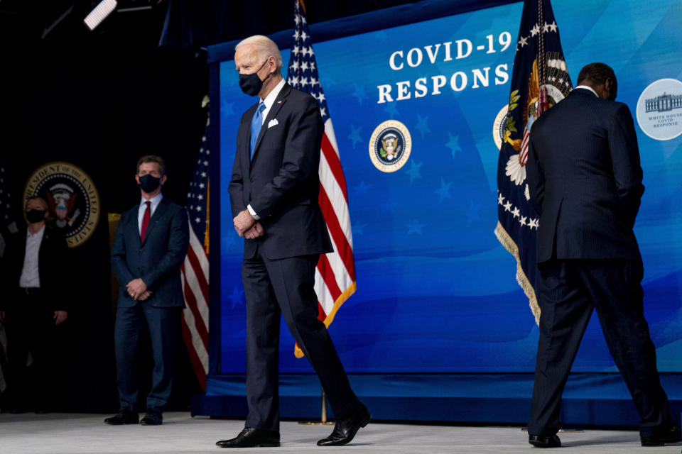 President Joe Biden, center, accompanied by Johnson and Johnson Chairman and CEO Alex Gorsky, left, and Merck Chairman and CEO Kenneth Frazier, right, takes the podium to speak at an event in the South Court Auditorium in the Eisenhower Executive Office Building on the White House Campus, Wednesday, March 10, 2021, in Washington. (AP Photo/Andrew Harnik)