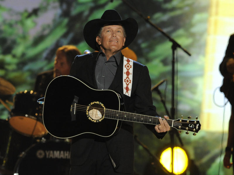 FILE - In this April 7, 2013 file photo, singer George Strait performs at the 48th Annual Academy of Country Music Awards at the MGM Grand Garden Arena in Las Vegas. The 2014 Academy of Country Music Awards in Las Vegas will air live Sunday night, April 6, 2014, from 8-11 p.m. EDT on CBS. Several awards, including top honor entertainer of the year, will be announced during the broadcast, to be hosted by Blake Shelton and Luke Bryan. Shelton, Bryan, George Strait, Miranda Lambert, Jason Aldean, Keith Urban, Tim McGraw, Shakira and Stevie Nicks are scheduled to perform. (Photo by Chris Pizzello/Invision/AP, file)