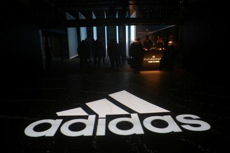 An Adidas logo is seen at the new Futurecraft shoe unveiling event in New York City, New York, U.S. April 6, 2017. REUTERS/Joe Penney/Files