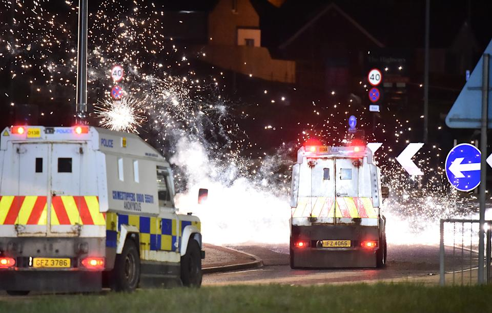 LARNE, NORTHERN IRELAND - APRIL 06: Police come under attack from fireworks and rocks as they unblock the main route into Larne town and harbour as Loyalists hold an anti Northern Ireland Protocol protest against the so called Irish Sea border on April 6, 2021 in Larne, Northern Ireland. (Photo by Charles McQuillan/Getty Images)