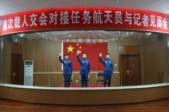 The crew of China's Shenzhou-9 mission, set to launch in June 2012, waves. L to R, Liu Yang (China's first female astronaut), Liu Wang, Jing Haipeng.