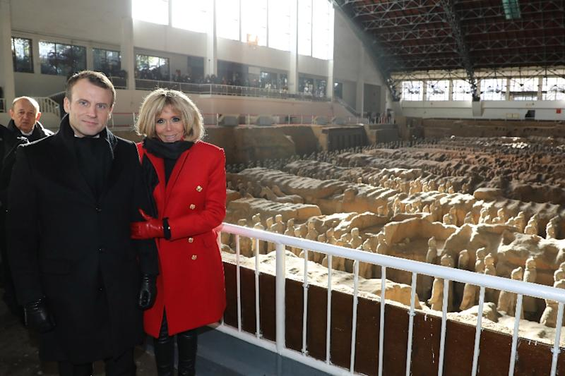 French President Emmanuel Macron and his wife Brigitte visit the famous terracotta warriors in Xian at the start of his first state visit to China