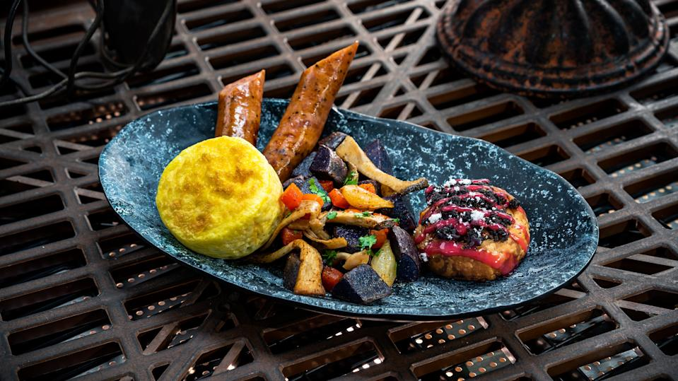 Galaxy's Edge puts an intergalactic twist on breakfast with the Bright Suns Morning. The meal, found at Docking Bay 7 Food and Cargo, features a three-cheese egg bite, pork sausage, purple potato hash and a mini Mustafarian lava roll. (Photo: David Nguyen/Disney Parks)