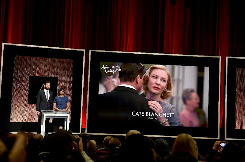 Actor John Krasinski and President of the Academy of Motion Picture Arts and Sciences Cheryl Boone Isaacs announce Cate Blanchett as a nominee for Best Actress in a Leading Role in the film 'Carol' on January 14, 2016 in Los Angeles (AFP Photo/Kevin Winter)