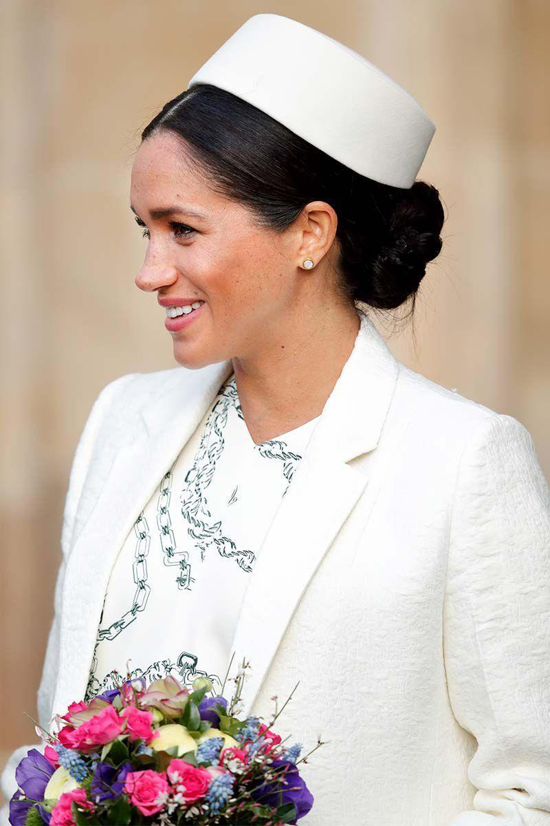 <p>Meghan sported a twisted chignon with her white pillbox hat for a Commonwealth Day service at Westminster Abbey.</p>
