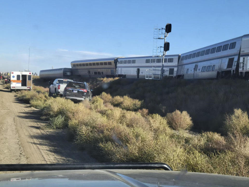 In this photo provided by Kimberly Fossen an ambulance is parked at the scene of an Amtrak train derailment on Saturday, Sept. 25, 2021, in north-central Montana. / Credit: Kimberly Fossen / AP