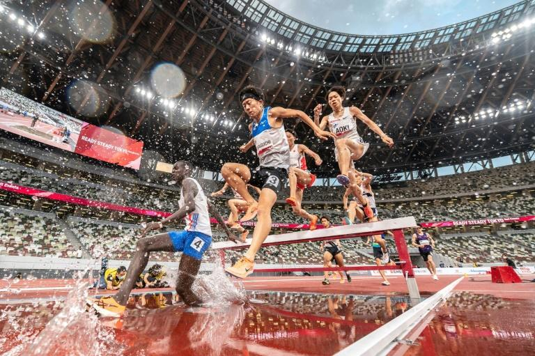 Piped in fake crowd noise echoed through the Tokyo Olympic stadium during an athletics event without fans