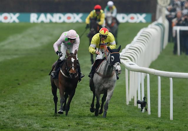 Horse Racing - Grand National Festival - Aintree Racecourse, Liverpool, Britain - April 13, 2018 Politologue ridden by Sam Twiston-Davies (R) leads Min ridden by Paul Townend before winning the 15:25 JLT Melling Chase Action Images via Reuters/Jason Cairnduff