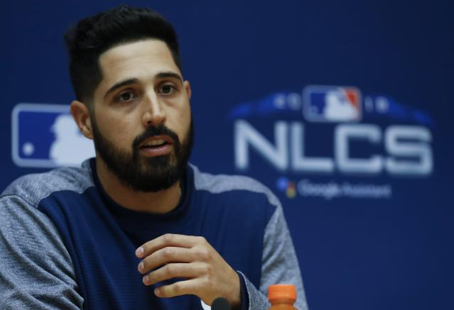 Milwaukee Brewers starting pitcher Gio Gonzalez answers questions at a news conference for Game 1 of the National League Championship Series baseball game against the Los Angeles Dodgers Thursday, Oct. 11, 2018, in Milwaukee. (AP Photo/Jeff Roberson)