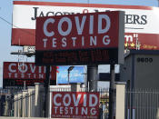 Advertisements for Covid-19 testing ares posted outside Los Angeles International Airport in Los Angeles, Friday, Nov. 13, 2020. California has become the second state to record 1 million confirmed coronavirus infections. The governors of California, Oregon and Washington issued travel advisories Friday, Nov. 13, 2020, urging people entering their states or returning from outside the states to self-quarantine to slow the spread of the coronavirus, California Gov. Gavin Newsom's office said. The advisories urge people to avoid non-essential out-of-state travel, ask people to self-quarantine for 14 days after arriving from another state or country and encourage residents to stay local, a statement said. (AP Photo/Damian Dovarganes)