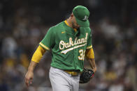 Oakland Athletics starting pitcher James Kaprielian walks off the field after being removed during the fifth inning of the team's baseball game against the San Diego Padres, Tuesday, July 27, 2021, in San Diego. (AP Photo/Derrick Tuskan)