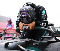 <em>Lewis Hamilton is overcome with emotion after his Turkish victory (Clive Mason/Getty Images).</em>