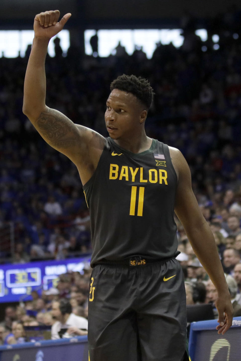 Baylor guard Mark Vital (11) gestures toward the bench during the second half of an NCAA college basketball game against Kansas in Lawrence, Kan., Saturday, Jan. 11, 2020. Baylor defeated Kansas 55-67. (AP Photo/Orlin Wagner)
