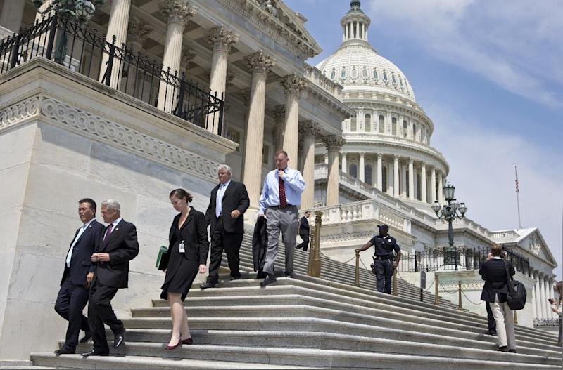 FILE - In this Friday, Aug. 2, 2013, file photo, members of Congress walk down the steps of the House of Representatives on Capitol Hill in Washington. The Treasury reports on the budget deficit for August on Thursday, Sept. 12, 2013. (AP Photo/J. Scott Applewhite, File)