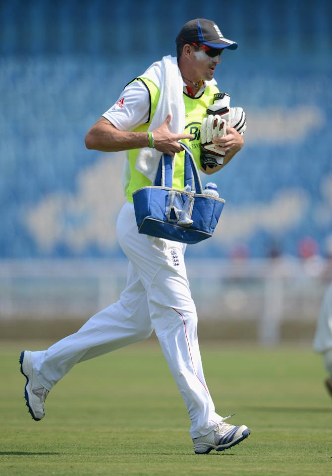 MUMBAI, INDIA - NOVEMBER 03:  England 12th man Kevin Pietersen brings on drinks during day one of the tour match between Mumbai A and England at The Dr D.Y. Palit Sports Stadium on November 3, 2012 in Mumbai, India.  (Photo by Gareth Copley/Getty Images)