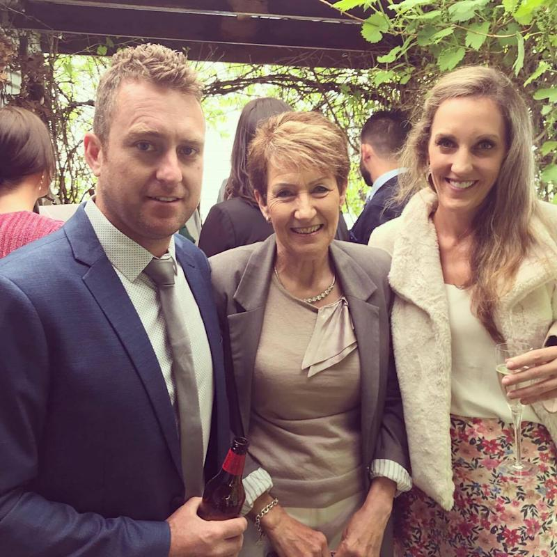 Jarrod is pictured posing in a suit with his mum Cheryl and sister Erin. Source: Supplied