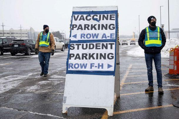 PHOTO: Parking lot attendants direct parking as people arrive for the coronavirus disease vaccines at a mass vaccination site at the Schoolcraft College, in Livonia, Mich., Feb. 5, 2021. (Emily Elconin/Reuters, FILE)