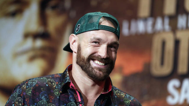 FILE - In this Sept. 11, 2019, file photo, Tyson Fury smiles during a news conference in Las Vegas. An all-British world heavyweight title showdown between Anthony Joshua and Tyson Fury in 2021 is a step closer. Fury said Wednesday, June 10, 2020, that an agreement has been reached with Joshua's camp on a two-fight deal between the current holders of the heavyweight belts. (AP Photo/Isaac Brekken, File)
