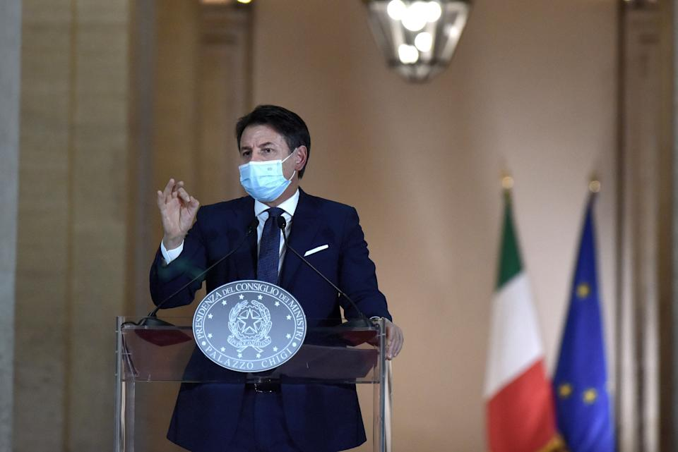 ROME, ITALY - OCTOBER 18: Italy's Prime Minister Giuseppe Conte announces new safety measures following a national surge of COVID-19 infections during a press conference at Palazzo Chigi on October 18, 2020 in Rome, Italy. Following this announcement local mayors will have the power to close public areas after 9pm with restaurant opening times and group sizes also being tightened. Bars and restaurants will have to close at midnight and after 6pm, only table service will be allowed, with maximum group sizes being six. Conferences and local festivals have been suspended and amateur contact sports will be stopped while gyms and swimming pools will have seven days to adapt to the new protocols. Starting times at schools will be later and more distance-learning will be encouraged, although these will mainly affect older pupils in high schools. Today Italy has registered 11705 new positive cases with 69 deaths.  (Photo by Simona Granati - Corbis/Getty Images,) (Photo: Simona Granati - Corbis via Getty Images)