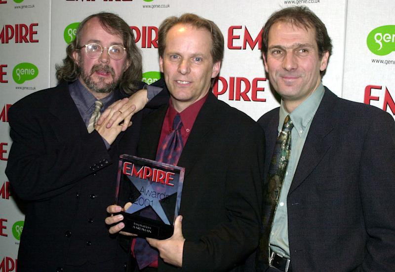 From left, animators Peter Lord, Nick Park and Dave Sproxton, who made the film Chicken Run, with their 2001 Empire Film Award for Inspiration at the Dorchester Hotel in London. (Photo by Matthew Fearn - PA Images/PA Images via Getty Images)