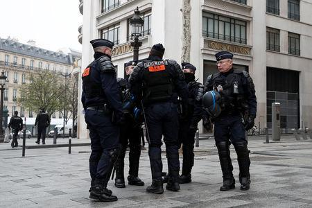"""French riot police officers secure the Champs-Elysees avenue in front of the Louis Vuitton store during the Act XIX (the 19th consecutive national protest on a Saturday) of the """"yellow vests"""" movement in Paris, France, March 23, 2019. REUTERS/Benoit Tessier"""